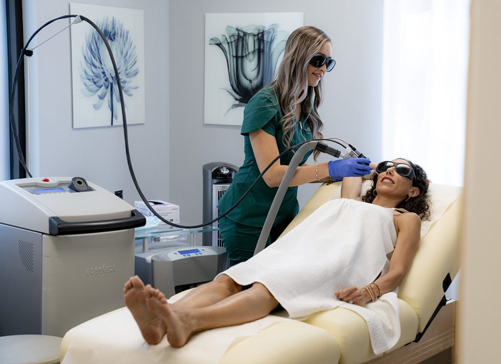 Woman getting laser hair removal on her lip at Pure Aesthetics