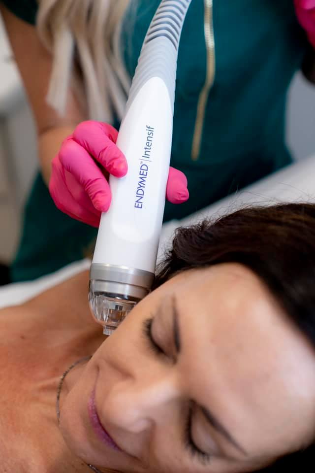 Woman getting Endymed microneedling treatment on her face